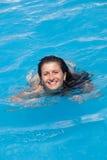 Smilling woman in swimming pool Stock Image