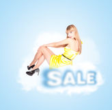 Smilling woman in yellow dress Royalty Free Stock Image