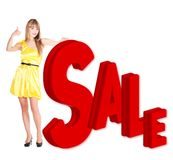 Smilling woman in yellow dress showing a sale word Stock Images