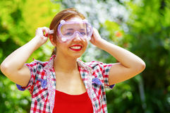 Smilling women with colorfull clothes putting on security glasses Royalty Free Stock Images