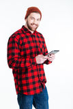 Smilling young hipster guy using pc tablet Royalty Free Stock Photos