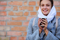 Smilling young woman with cup coffee Stock Image