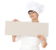Lady cook showing blank sign Stock Photos