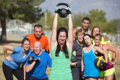 Smilng Lady Lifting Kettle Bell stock photo