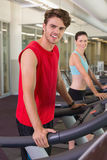 Smilng man and woman on the treadmills Stock Photo