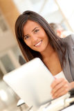 Smilng office worker with tablet stock images