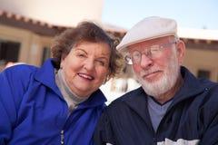 Smilng Senior Adult Couple Bundled Up Outdoors. Happy Senior Adult Couple Portrait Bundled Up Outdoors royalty free stock photo