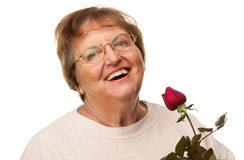 Smilng Senior Woman with Red Rose Royalty Free Stock Image