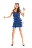 Smilong dancing woman in purple dress Stock Photo
