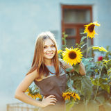 Smily  beautiful girl with sun flower Royalty Free Stock Images
