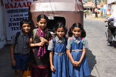 Smily children on the street of India. Unidentified schoolchildren are returning from the studies in Kochi, India. Kerala is the most educatedindian state. The Stock Images