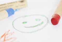 Smily Face Drawn with Coloured Crayons. Stock Photo
