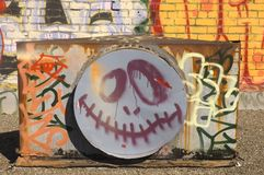 Smily face graffitti. Smiling halloween face Graffitti on brick wall Royalty Free Stock Image