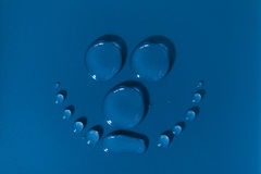 Smily face made of water drops Royalty Free Stock Image