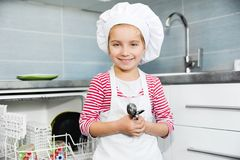 Little girl on the kitchen Stock Photography