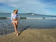 Smily New Zealand Girl. Cheerful New Zealand girl on the beach Royalty Free Stock Images