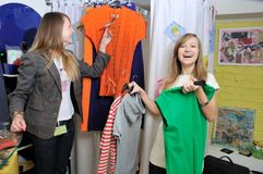 Smily shopping. Buyer and seller choose clothes and smiling Stock Photos