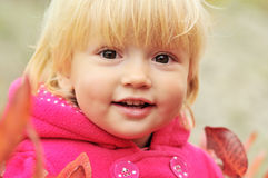 Smily toddler. Girl in fall time Royalty Free Stock Photos