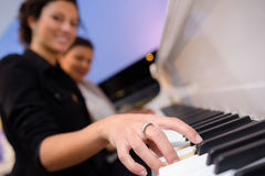 Smily woman playing piano Stock Photo