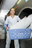 Smily woman working at industrial laundry Stock Photography