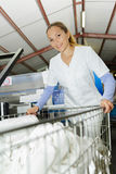 Smily woman working at laundry Stock Images