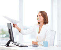 Sming businesswoman giving papers in office. Business adn education concept - smiling businesswoman giving papers in office stock photos