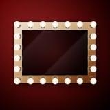 Sminkspegel med ljusa kulor Arkivbild
