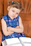 Smirk. Funny girl smirk, photoalbum lies on knee royalty free stock images