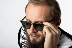 Smirk. A man with black sunglasses stock photo