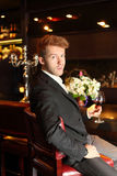 Man in suit holding a glass of wine Royalty Free Stock Photography