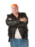 Smirking. Biker gang member with leather jacket Royalty Free Stock Photo