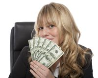 Smirking Businesswoman With A Fistful Of Dollars Royalty Free Stock Photos