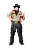 Smirking cowboy with a bottle Royalty Free Stock Photo