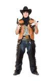 Smirking cowboy with a gun Royalty Free Stock Image