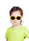Smirking cute little girl with sunglasses Stock Photos