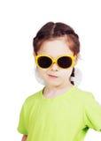 Smirking cute little girl with sunglasses Stock Photos
