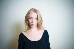 Smirking young blonde woman portrait Stock Image