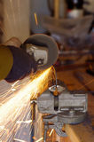 The smith are cutting steel Royalty Free Stock Images