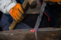 Smith forging hot iron Stock Photo