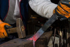 Smith forging hot iron Royalty Free Stock Image