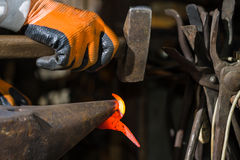 Smith forging hot iron Royalty Free Stock Photography