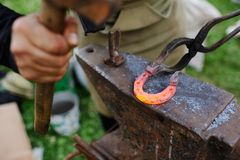 The smith makes a horseshoe on the anvil Stock Photography