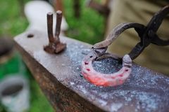 The smith makes a horseshoe on the anvil Royalty Free Stock Photography