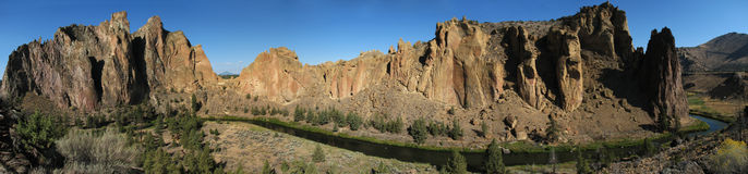Smith rock panorama. Panorama of the front side of Smith Rock state park, Oregon with the crooked river and cliffs and a clear blue sky Stock Image