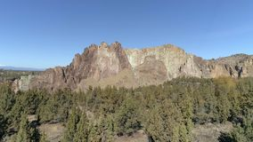 Smith Rock State Park Aerial. Smith Rock State park in Terrebonne, Oregon is a destination location for hiking and a world renowned rock climbing mecca.  It is stock video