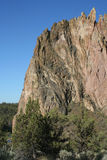 Smith Rock State Park - Terrebonne, Oregon. Smith Rock is a 550 foot towering mass of rock just east of Terrebonne, Oregon.  The formation originated from an Stock Photo