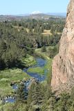 Smith Rock State Park - Terrebonne, Oregon. Smith Rock is a 550 foot towering mass of rock just east of Terrebonne, Oregon.  The formation originated from an Stock Photos
