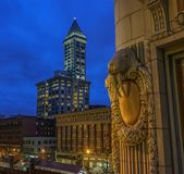 Smith Tower, Seattle, Wa USA. Smith Tower to left with a shaded window with walrus detail of the Arctic Building in forreground Royalty Free Stock Photos
