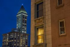 Smith Tower, Seattle, Wa USA. Smith Tower to left with a shaded window with lamp in foreground stock images