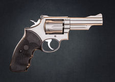 Smith & Wesson 357 Magnum Revolver on Grundge Back. Smith & Wesson 357 Magnum Revolver isolated on Gray Grundge Background royalty free stock photo